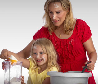 Photo of mother and daughter baking a cake